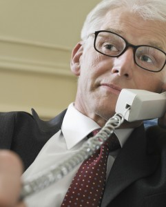 hearing impaired person listening on the phone